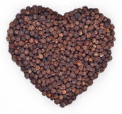 Black pepper in the form of heart on a white Royalty Free Stock Image
