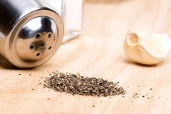 Black pepper and garlic clove Royalty Free Stock Photography