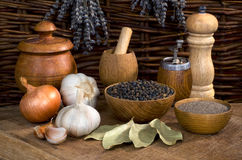 Black pepper and garlic on the wooden table Royalty Free Stock Photo