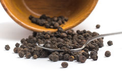 Black pepper grains into a bowl Royalty Free Stock Photos