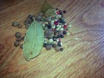 Black pepper grains Natural spice stock photo