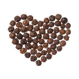 Black pepper heart isolated on white background Royalty Free Stock Photo