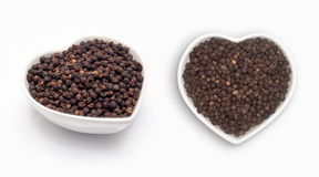 Black pepper  in a heart shaped bowl Stock Photo