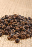 Black pepper on hessian Stock Photo