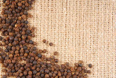 Black pepper on hessian. Fabric frame royalty free stock photography