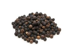 Black pepper isolated. On the white background Royalty Free Stock Photos