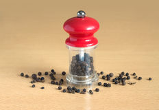 Black pepper and manual mill on wood Royalty Free Stock Images