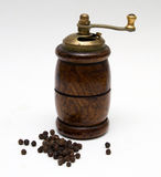 Black pepper with a mill Royalty Free Stock Photography