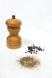 Black pepper and mill Royalty Free Stock Photography