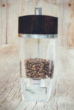 Black pepper in a mill on the old rustic table Royalty Free Stock Photo