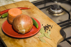Black pepper, Onion and carrot on wooden desk Royalty Free Stock Images