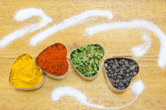 Black pepper, paprika, curry and basil Royalty Free Stock Photos