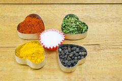 Black pepper, paprika, curry, basil and salt Stock Photography
