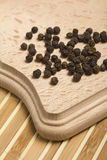 Black pepper peas and parsley twig Royalty Free Stock Photography