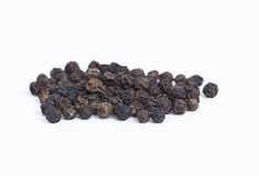 Black Pepper. A pile of black pepper grains isolated on white background royalty free stock image