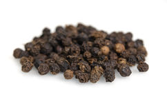 Black pepper, piper nigrum, isolated on white background Royalty Free Stock Images