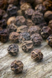 Black pepper. (Piper nigrum) on the wooden table Stock Photo