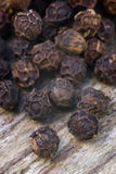 Black pepper. (Piper nigrum) on the wooden table Royalty Free Stock Photo