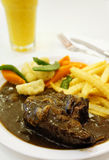 Black pepper rib eye steak with orange juice Stock Photo