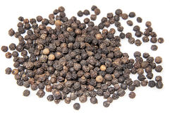 Black pepper seeds. Pile on white background royalty free stock images