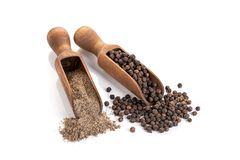 Black pepper seeds and Black pepper ground isolated on white background. Copy space. Piper nigrum stock photo