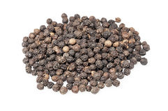 Black pepper seeds. Pile on white background royalty free stock photo