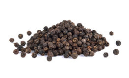 Black pepper seeds on white background Stock Photos