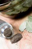 Black pepper in shaker and bay leaves Stock Image