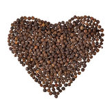 Black pepper in shape of heart Royalty Free Stock Images