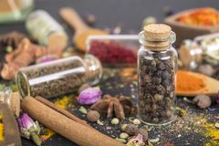Black pepper. Spice in glass jars on black royalty free stock photos