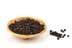 Black pepper, spices, medicinal properties in a basket on a white background. Royalty Free Stock Photography