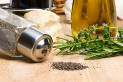 Black pepper and spicy herbs Royalty Free Stock Photography