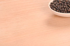 Black pepper with spoon Stock Photos