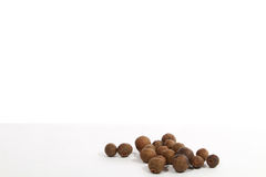 Black pepper was placed on a white. Background stock images