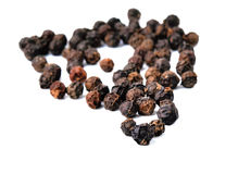 Black pepper was placed on a white background. Black pepper was placed isolated on a white background Royalty Free Stock Image