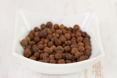 Black pepper in white bowl Royalty Free Stock Photos
