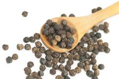 Black pepper on white Stock Photography