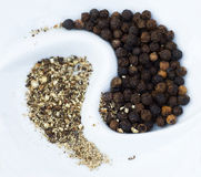 Black pepper on white closeup stock photos