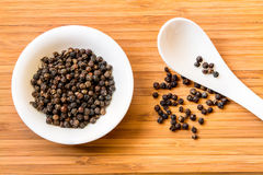 Black pepper in white dish Stock Images