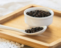 Black pepper on wood background Stock Photography
