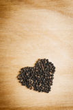 Black pepper on wood table Royalty Free Stock Image