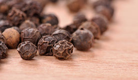 Black pepper on the wooden board Stock Image