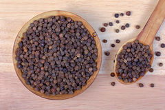 Black pepper in a wooden bowl Royalty Free Stock Photo