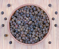 Black pepper in a wooden bowl Stock Images