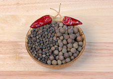 Black pepper  in a wooden bowl Stock Photography