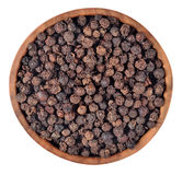 Black pepper in a wooden bowl on a white Royalty Free Stock Image
