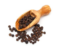 Black pepper in a wooden scoop Stock Images