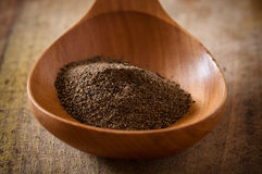 Black pepper on wooden spoon Royalty Free Stock Images