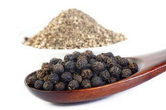 Black pepper at in wooden spoon Stock Image
