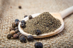Black pepper on the wooden spoon stock image